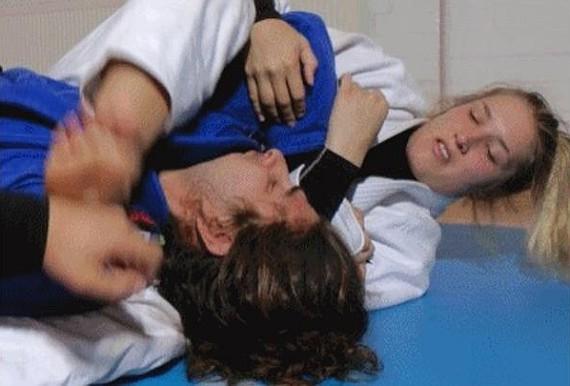 Diana v guy in judo gi wrestling fight